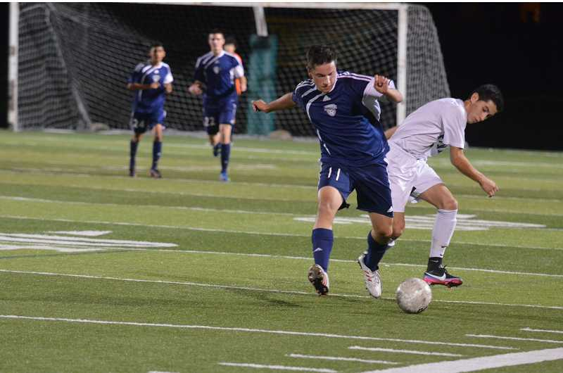 by: JEFF GOODMAN / FILE - Junior midfielder Adam Kane (11), shown during a league game at Putnam, and the Wilsonville boys soccer team fell to Bend-Summit in the Class 5A semifinals on the road Nov. 12. The Wildcats reached the penultimate round for the first time since 2002.