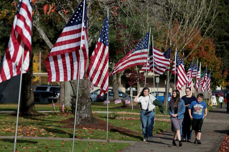 by: TIMES PHOTO: JONATHAN HOUSE - American flags line Veterans' Memorial Park in Beaverton as part of a patriotic tribute on Veterans Day.