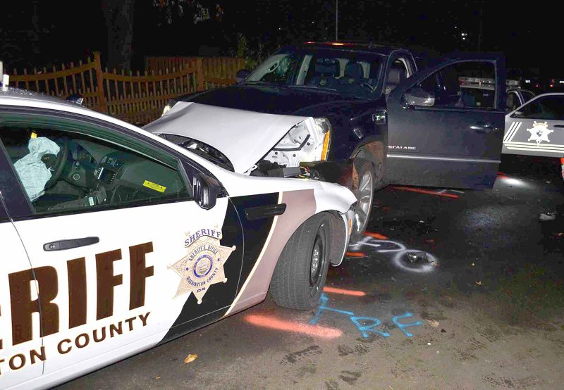 by: COURTESY OF WCSO - Washington County sheriff's deputies used their patrol cars to pin a Cadillac Escalade driven by Dave Dahl of Milwaukie after a short pursuit in Cedar Hills Thursday night, Nov. 14. Dahl was released from jail Saturday.