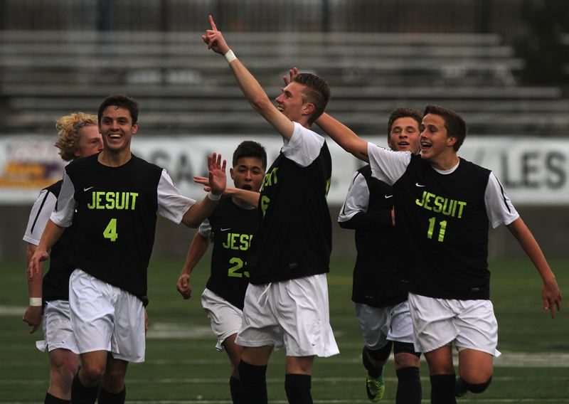 by: TRIBUNE PHOTO: JONATHAN HOUSE - Jesuit's Christopher Chertude (center) celebrates his goal in the sixth minute of the 6A title game with teammates, including Spencer Scott (left) and Chase Boone (right). The Crusaders beat Central Catholic 2-1 .