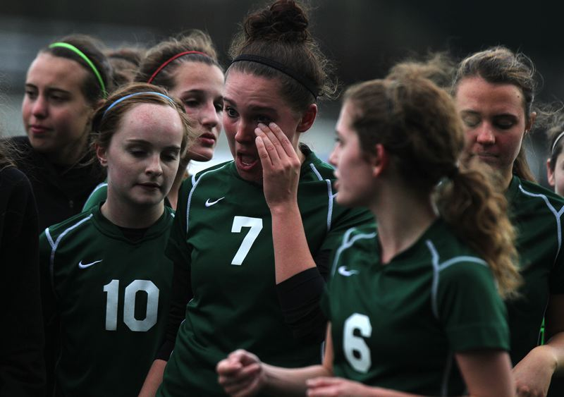 by: TRIBUNE PHOTO: JONATHAN HOUSE - Wilson's Kenna Meinhart (center), who scored both of her team's goals, wipes away a tear after the Trojans' 4-2 loss to No. 1-ranked Summit in the 5A girls championship game Saturday at Hillsboro Stadium. Teammates, including Mara McLaughlin (10) and Dana Nathanson (6), share the postgame moments.