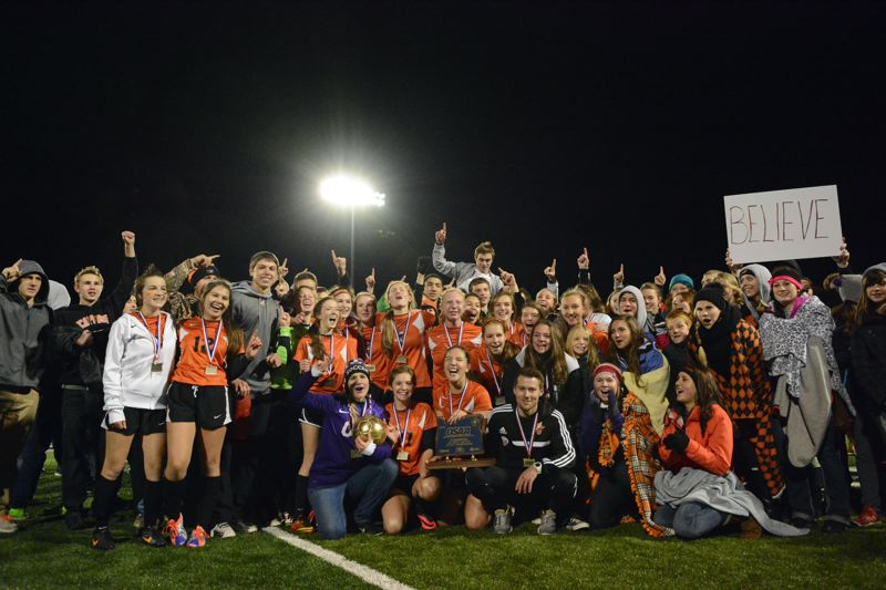 by: JOHN WILLIAM HOWARD - The Scappoose girls' soccer team and their fans celebrate the Indians' 3-1 victory to claim the state title from La Grande.