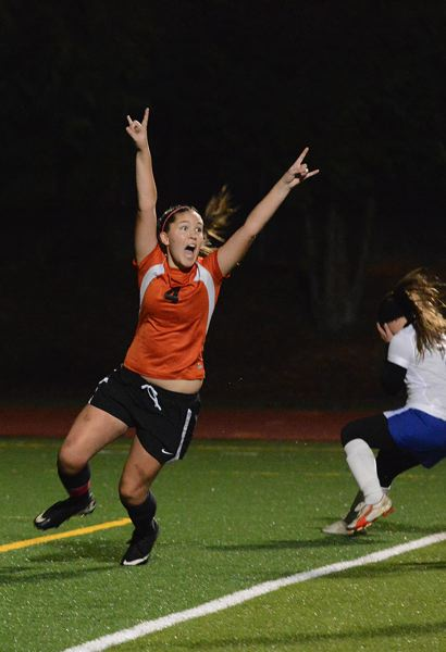 by: JOHN WILLIAM HOWARD - Tribe defender Emily Muth reacts to scoring the Indians' first goal of the match. It was Muth's touch that pulled Scappoose even with La Grande in the first half.