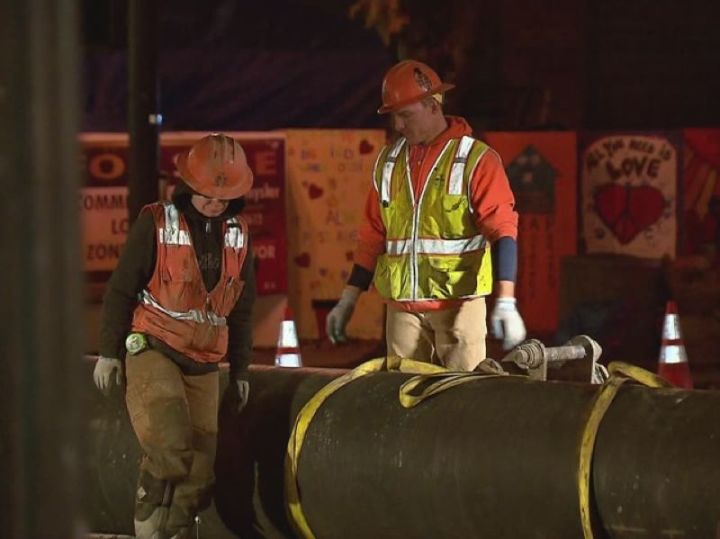 by: KOIN NEWS 6 - Workers inspect 100-year-old water main that broke near Old Town on Oct. 29, flooding streets and closing businesses around SW 4th and Burnside.