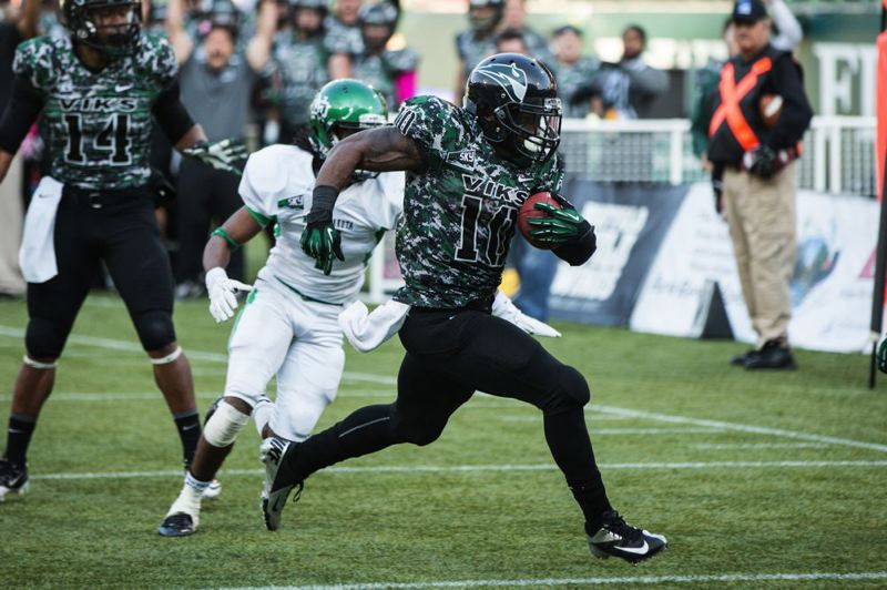 by: COURTESY OF DAVID BLAIR - DJ Adams runs for the winning Portland State touchdown against North Dakota.