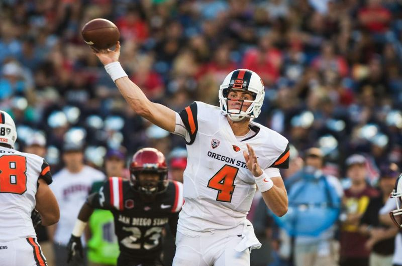 by: COURTESY OF OREGON STATE UNIVERSITY - Sean Mannion and Oregon State take on the Washington Huskies on Saturday at Corvallis.
