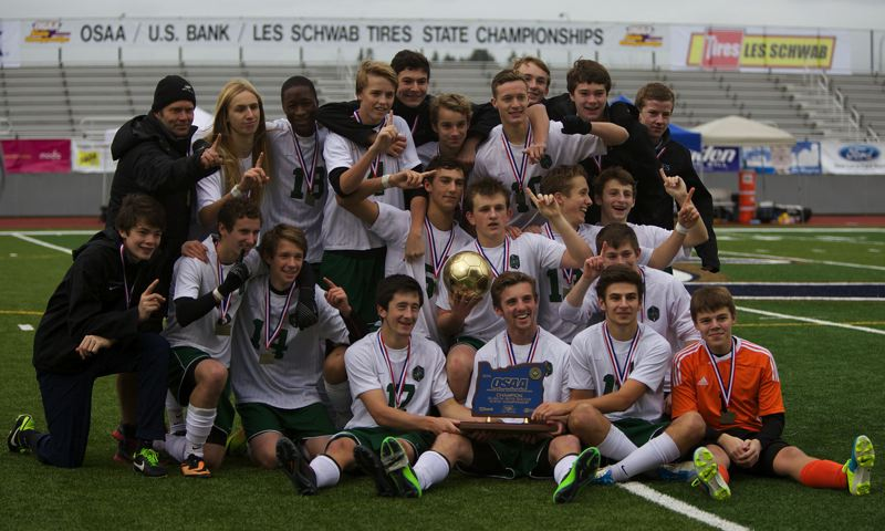by: COURTESY OF JOHN HOLLORAN - The Oregon Episcopal School boys soccer team celebrates its 2013 Class 3A/2A/1A state championship Saturday at Liberty High, after defeating St. Mary's 2-1 in the final.