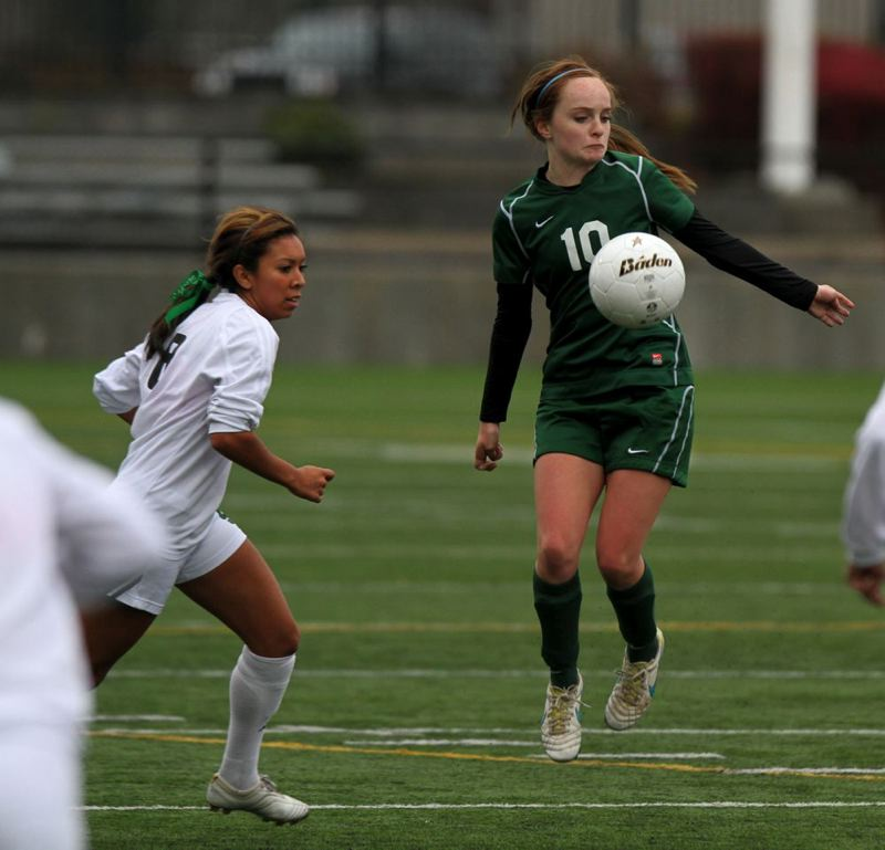 Mara McLaughlin (right) of Wilson gains control near midfield, ahead of Summit's Raja Char.