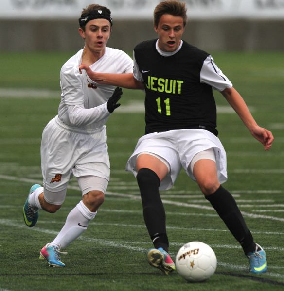 Chase Boone (right) of Jesuit holds off Central Catholic's Peter Bergmann.