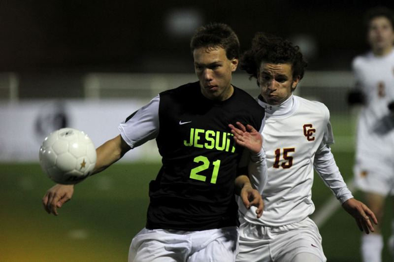 Chris Arpan (left) of Jesuit beats Central Catholic's Cristian Arnston to the ball.