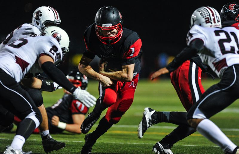 by: JOHN LARIVIERE - It was the Dan Sherrell Show Friday night at Clackamas High School, as the Cavalier senior running back ran around, through and over Glencoe defenders for 302 yards and six touchdowns. Sherrell (1) had 258 yards and five touchdowns at halftime.