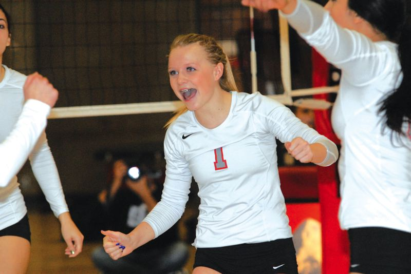 by: SANDY POST: DAVID BALL - Mt. Hood setter Shea Lindsey celebrates a point during last weeks sweep over Chemeketa.