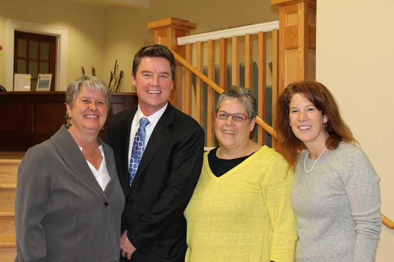by: SPOKESMAN PHOTO: KATE HOOTS - Three Rivers Charter School representatives were all smiles after the school board voted to renew the schools charter. From left, co-founder and board co-chairwoman Marilee Bales, co-chairman Russ Lewis, co-Founder and principal Katherine Holtgraves and board member Liz Lampson.