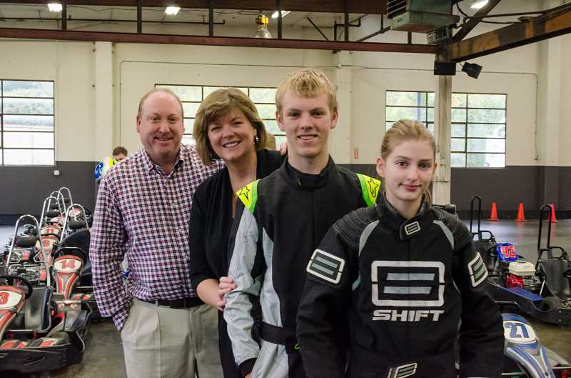 by: SUBMITTED PHOTOS - The racing Mooneys of West Linn are, from left, father Rick, mother Kelly, son Zach and daughter Alexis.