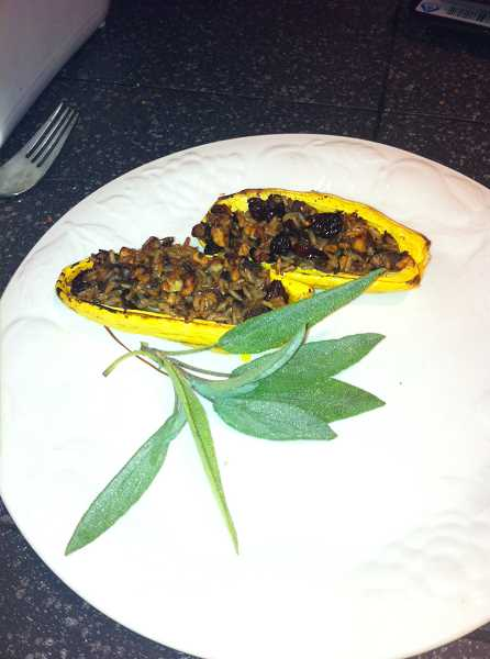 by: STAFF PHOTO: BARB RANDALL - Delicata Squash Stuffed with Mushrooms, Farro and Cranberries is a vegan recipe that is appealing and delicious for all to enjoy.
