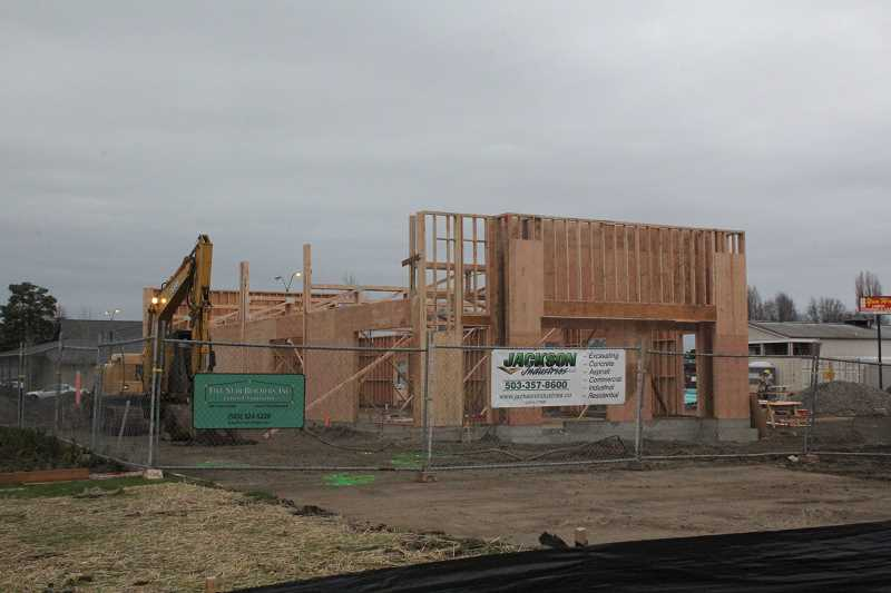 by: JEFF MCDONALD  - A new KFC restaurant is under construction north of Highway 214 in Woodburn. The 3,300 square-foot restaurant will open by late winter or early spring, depending on weather.