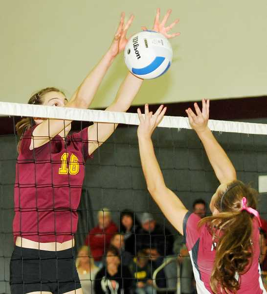by: SETH GORDON - Mikaela Raudsepp collects one of her 53 solo blocks during a district playoff game versus Perrydale earlier this fall. Raudsepp was a dominating force in the Casco League, earning Player of the Year honors. T