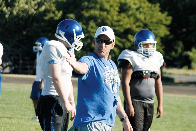 by: PHIL HAWKINS - St. Paul football coach Tony Smith, Casco Coach of the Year