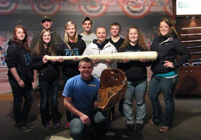 by: SUBMITTED - North Marion and Gervais FFA students and advisers spent nine days in Kentucky and Tennessee, mainly for the National FFA Convention in Louisville, Ky. (right), which attracted more than 60,000 students nationwide. The group also visited places like the Louisville Slugger museum and factory.