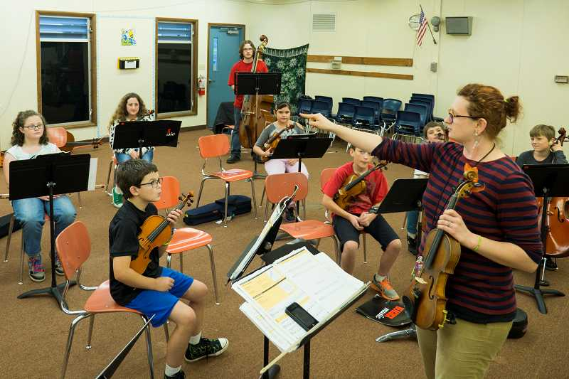 by: NEWS-TIMES PHOTO: CHASE ALLGOOD - In college, Burgess learned about the Kodaly Pedagogy, which emphasizes music as the born right of every child and a crucial part of their learning and understanding of their culture, Burgess explained.