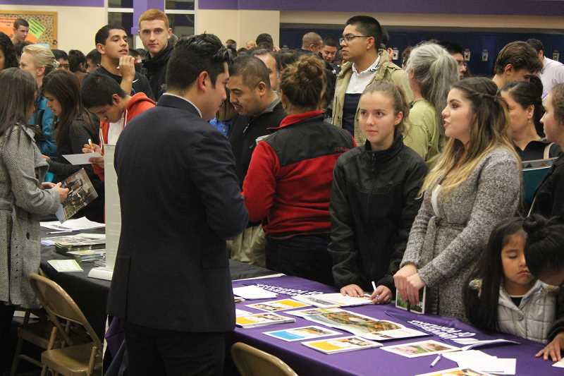 by: LINDSAY KEEFER - College Night at Woodburn High School last Thursday attracted more than 300 students and their families, as well as 13 colleges and a representative from the U.S. Navy.