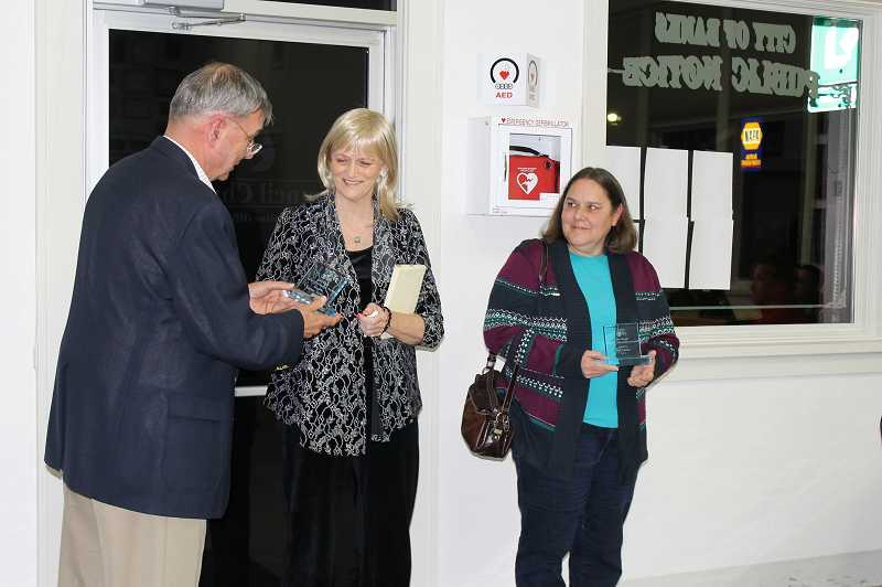 by: NEWS-TIMES PHOTO: STEPHANIE HAUGEN - The council meeting took a recess to celebrate with cake a punch after former City Manager Jim Hough presented the annual citizenship award to Kathie Jackson and June Lucas, who accepted the award on behalf of her late husband, Jim Lucas.