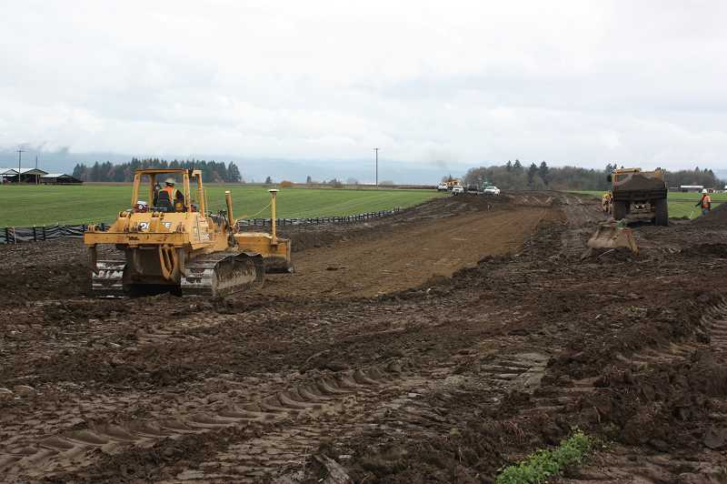 by: HILLSBORO TRIBUNE PHOTO: DOUG BURKHARDT - Heavy equipment is being used to build a new roadbed for the Portland & Western Railroad at this site off Wilkesboro Road near Banks. The project is expected to be completed in December.