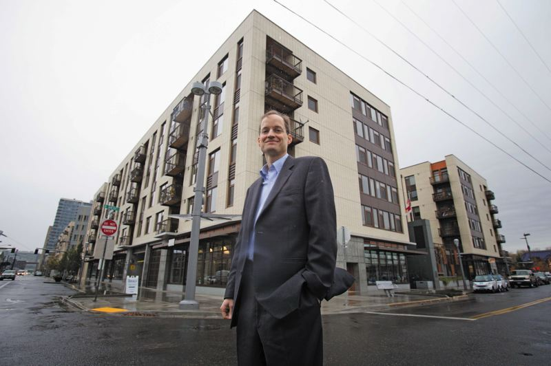 by: TRIBUNE PHOTO: JONATHAN HOUSE - Dan Valliere is CEO of REACH, an affordable housing organization based in the Grays Landing building, which it developed in South Waterfront.