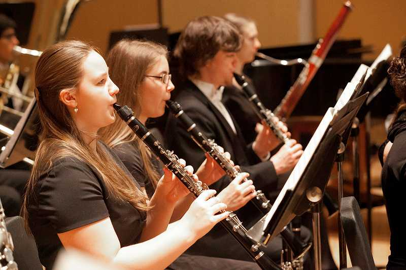 by: COURTESY PHOTOS: HIROSHI IWAYA - Sophomore Ashley Crittenden, senior Callie Harland and Junior Nick Greenwood play clarinet (above, left to right), while sophomore Jackie Graddon plays bassoon with the Pacific Philharmonic. At right, sophomore violinist Alex Heine performs with the symphony.