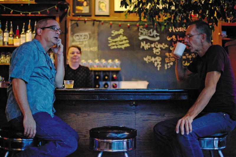 by: TRIBUNE PHOTO: ADAM WICKHAM - Bill Leeds (left) and David Lee Williams are two of the three co-owners of the Laurelthirst Public House. Williams helped start the club 25 years ago.