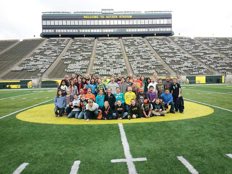 by: SUBMITTED PHOTO - Culver sixth-graders pose on the 50-yard line at Autzen Stadium during their Nov. 14 tour of the University of Oregon in Eugene.