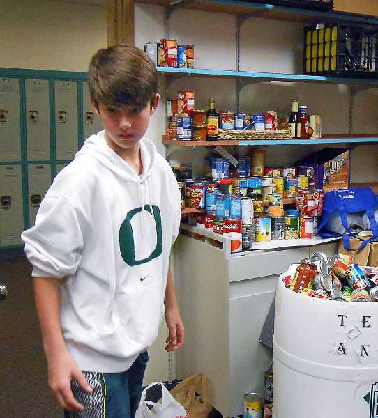 by: REVIEW PHOTO: JILLIAN DALEY - Lakeridge Junior High School seventh-grader Jake Leaverton was among students in a leadership class who coordinated a food drive at the school.