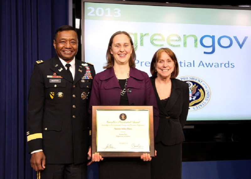 by: SUBMITTED PHOTO - From left, the U.S. Army Chief of Engineers Lt. Gen. Thomas Bostick; Jeanette Fiess, an electrical engineer for USACE, Northwestern Division; and Hon. Jo Ellen Darcy, assistant secretary of the Army for Civil Works, display the GreenGov Presidential Award-Sustainability Hero plaque that Fiess received at a ceremony in Washington, D.C.