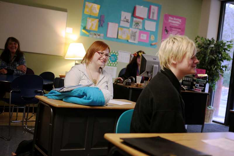 by: TIMES PHOTO: JONATHAN HOUSE - Mariah Williamsom laughs while sharing a story during a class exercise about overcoming obstacles in life at the Cascade Academy in Beaverton.