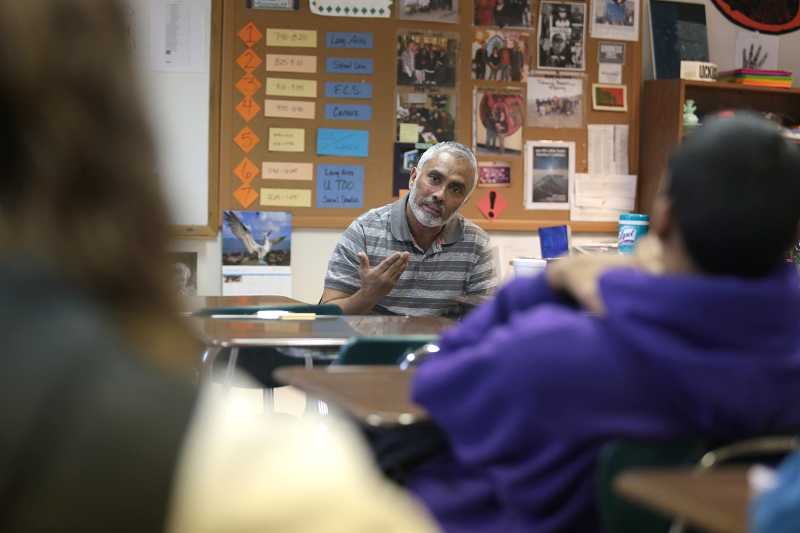 by: TIMES PHOTO: JONATHAN HOUSE - Shariar Ahmed, a muslim and teacher at the Bilal Masjid Mosque, talks to students at the Cascade Academy in Beaverton about Islam and the importance of helping and loving others.