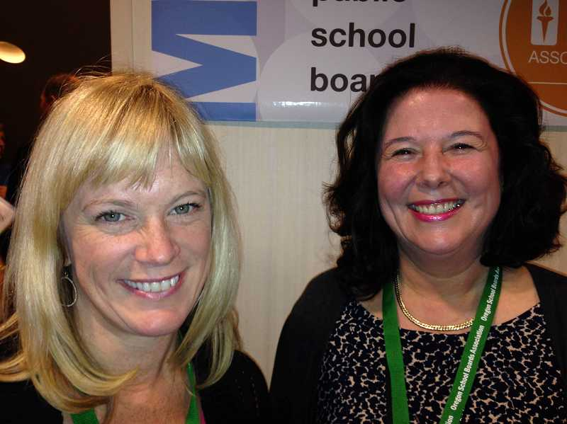 by: SUBMITTED PHOTO: ALEX PULASKI - Lake Oswego Board members Sarah Howell, left, and Liz Hartman pause for a quick snapshot at an Oregon School Boards Association conference earlier this month.