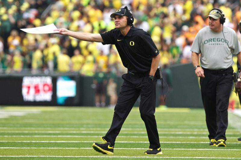 by: TRIBUNE PHOTO: JAIME VALDEZ - Mark Helfrich makes his first trip to Tucson as Oregon's head coach this weekend.