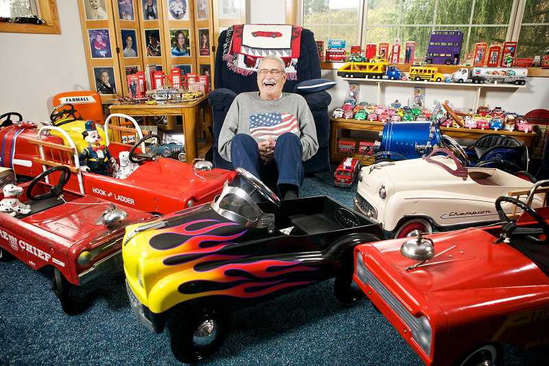 by: TIMES PHOTO: JAIME VALDEZ - Tigard resident Gerald Barron collects toys. Lots and lots of toys. The former transportation director has thousands of toy cars, planes, trains, busses and other items, which he has been collecting for the better part of three decades.