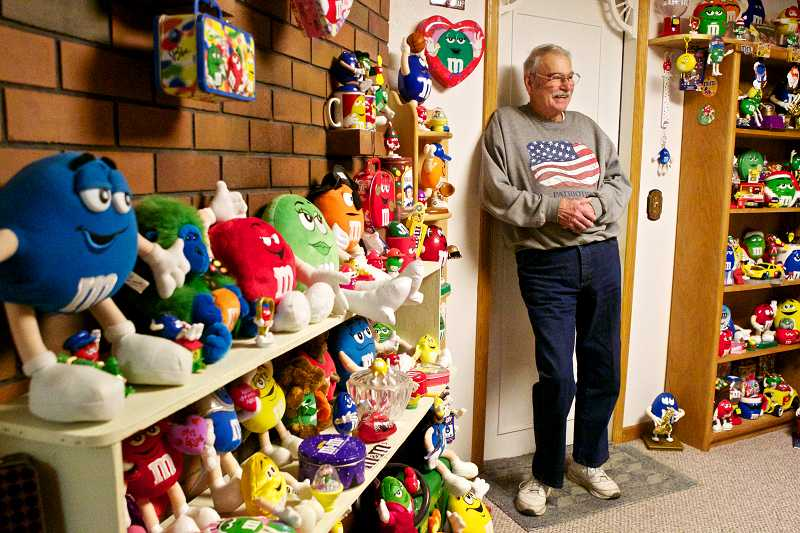 by: TIMES PHOTO: JAIME VALDEZ - Tigard resident Gerald Barrons collection includes more than 1,000 pieces of M&M merchandise, including candy dispensers, phones and figurines.