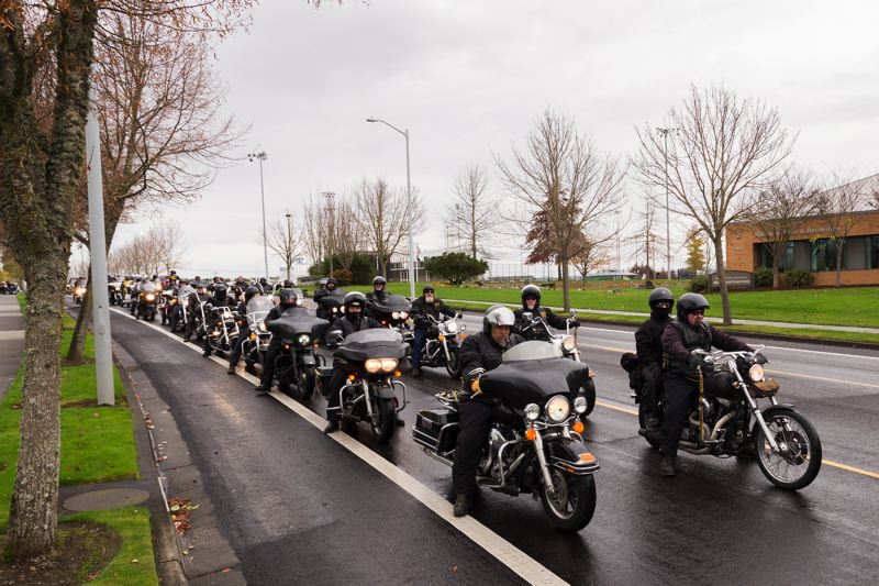 by: HILLSBORO TRIBUNE PHOTOS: CHASE ALLGOOD - Bikers on a mission to spread good cheer over the holidays line up before their convoy gets under way.
