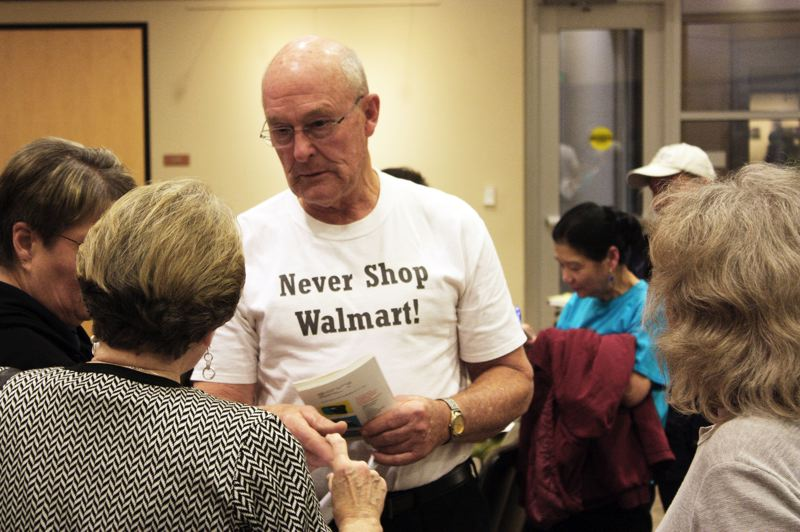 by: HILLSBORO TRIBUNE PHOTO: DOUG BURKHARDT - Vernon Mock, a strong critic of WalMarts development plans, displayed his viewpoint right up front at a Nov. 13 public hearing.