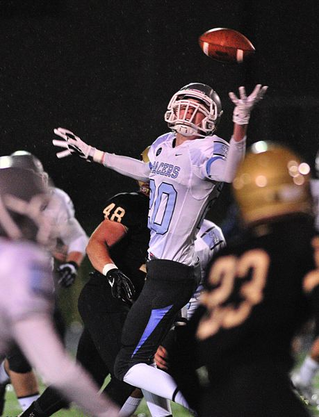 by: VERN UYETAKE - Joe Sindlinger hauls in a one-handed catch during Lakeridge's 28-20 victory over Southridge on Friday which propelled Lakeridge into the quarterfinals.
