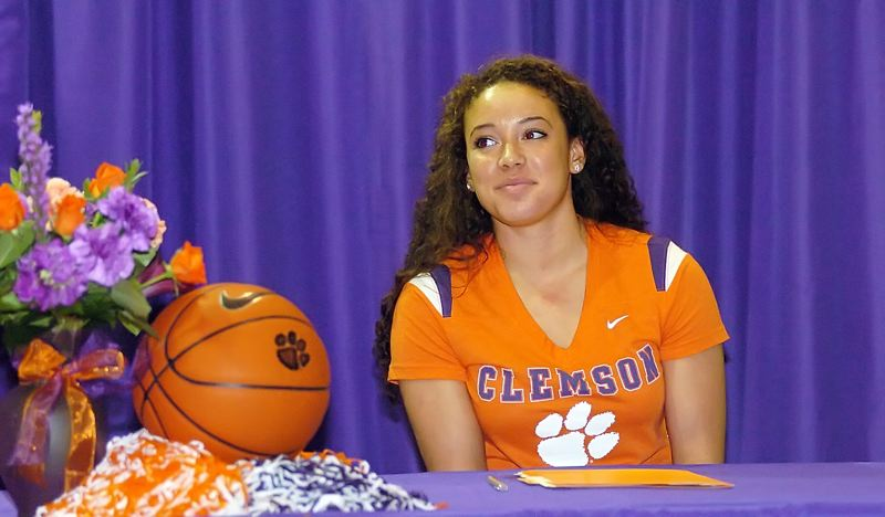 by: DAN BROOD - BIRTHDAY GIRL -- Tigard High School senior Lexi Carter, on her 18th birthday, signed a National Letter of Intent to play college basketball at Clemson University.