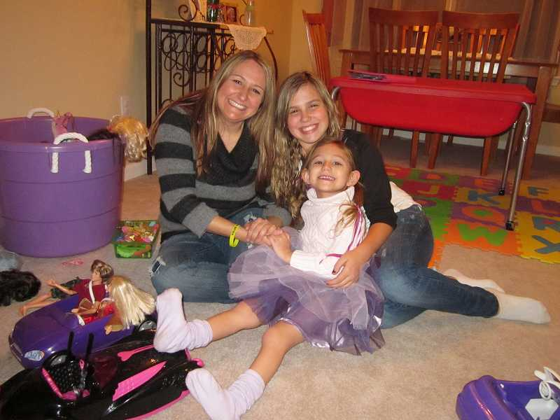 by: RAY PITZ - Angi Muckey with her daughters Ema, 11, and Mya, 4, share happy times in their Sherwood home when Mya, who has spina bifida, isn't hospitalized with ongoing surgeries and medical treatments.