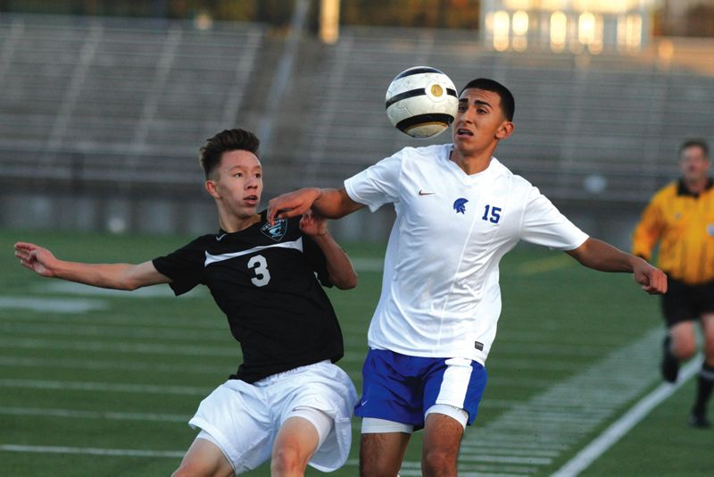 by: HILLSBORO TRIBUNE PHOTO: AMANDA MILES - Hillsboro's Abran Serrano Garcia (15) battles Century's Christian Acosta for a loose ball this fall. Serrano Garcia was recently named the Pacific Conference player of the year.