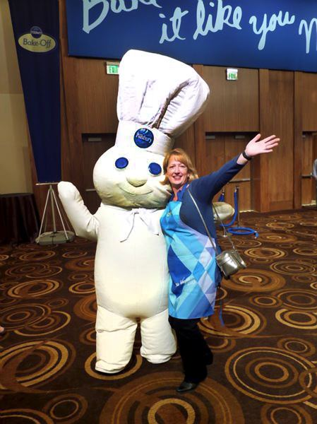 by: CONTRIBUTED PHOTO: WESTERBACK FAMILY - Carolyn Westerback with the Pillsbury Doughboy at the bake-off in Las Vegas.