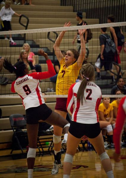 by: TRIBUNE FILE PHOTO: JONATHAN HOUSE - Camille Foster of Central Catholic, challenging a Clackamas play at the net, is the Mt. Hood Conference player of the year in volleyball.