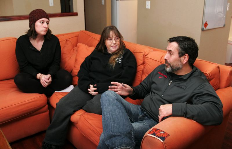 by: OUTLOOK PHOTO: JIM CLARK - In the living room of their home, from left, residents Whitney Jett and Mollie Dundas, and Oxford House state coordinator Edward Smith.