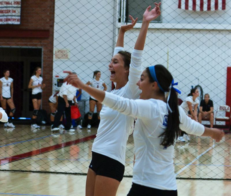 by: COURTESY OF CAL STATE SAN MARCOS - Kara Barkdoll (left) and Alyssa Foster, former Central Catholic High standouts, celebrate a point for their Cal State San Marcos volleyball team, which is in the NAIA playoffs.