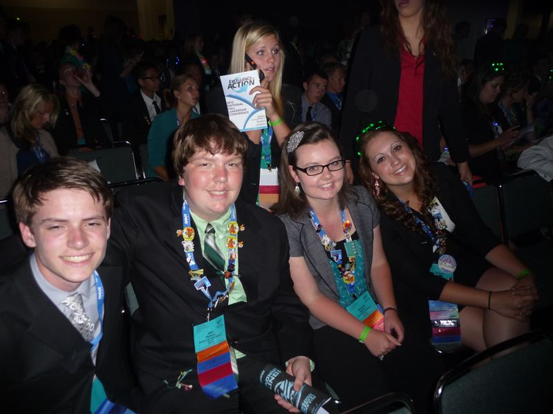 by: SUBMITTED PHOTO - Parker Snook, Scappoose High School junior, and Jake Stafford, SHS Senior, were granted the opportunity to represent their school at the Future Business Leadership Conference last June in Aniheim, Calif. Also pictured are Melanie Naillon and Makayla Bennett, St. Helens High School Seniors who also qualified for the event.